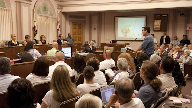 The Stockton City Council listens to statements from citizens Tuesday, June 26, 2012, in Stockton, Calif. Stockton officials continue to grapple with the city's financial plight, struggling to restructure millions of dollars of debt threatening to turn the city with the nation's second highest foreclosure rate into the largest American city to file for bankruptcy. (AP Photo/Ben Margot)