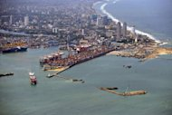 Photo illustration shows the port of Colombo. An oil slick from a rusting cargo vessel that sank in bad weather reached the coast of Sri Lanka&#39;s capital Saturday, but officials insisted the spill was &quot;manageable&quot; and could easily be cleaned up