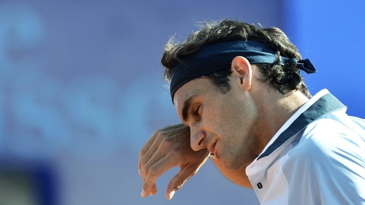 Roger Federer of Switzerland reacts during his match against Daniel Brands of Germany , a second round match at the Suisse Open tennis tournament in Gstaad, Switzerland, Thursday July 25, 2013. (AP Photo/Keystone/Peter Schneider)