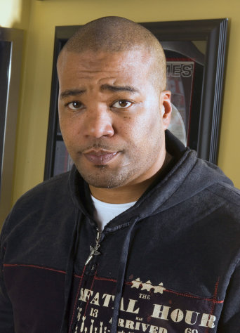 FILE - This Feb. 28, 2007 file photo shows hip-hop mogul Chris Lighty in his office in New York. Lightly died of an apparent gunshot wound on Thursday, Aug. 30, 2012 at his home in the Bronx borough of New York. He was 44. Lighty was the man behind raps leading figures, helping them not only attain hit records, but lucrative careers outside of music. He had been a part of the rap scene for decades, working with pioneers like LL Cool J, KRS-One before starting his own management company, Violator.(AP Photo/Jim Cooper, file)