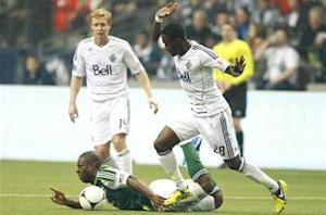 Whitecaps make playoffs despite loss to Timbers