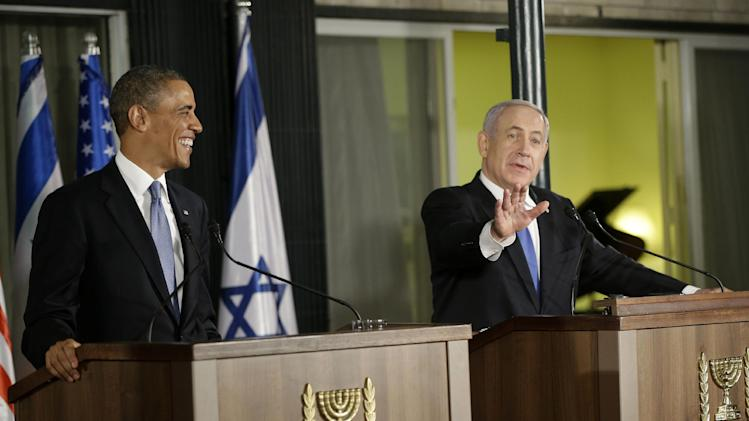 President Barack Obama and Israeli Prime Minister Benjamin Netanyahu react to US television journalist Chuck Todd, from NBC, asking addition follow-up questions during a joint news conference in Jerusalem, Israel,Wednesday, March 20, 2013. (AP Photo/Pablo Martinez Monsivais)