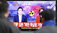 South Korean passengers watch TV news reporting North Korea&#39;s apparent nuclear test, at the Seoul train station on February 12, 2013. North Korea has confirmed that it conducted a nuclear test