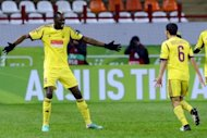 FC Anzhi Makhachkala's Lacina Traore (L) celebrates with Mbark Boussoufa after scoring a goal during their UEFA Europa League group A football match in Moscow. Anzhi Makhachkala moved to the top of Europa League Group A as they leapfrogged Liverpool with a 1-0 win thanks to a lone Traore goal in freezing temperatures in Moscow