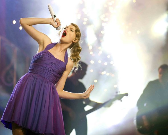 FILE - This Nov. 22, 2011 file photo shows singer Taylor Swift performing at Madison Square Garden in New York. Swift will be among many top performers at the iHeartRadio Music Festival in Las Vegas this weekend. The two-day festival at the MGM Grand features an A-List lineup of stars including Swift, Aerosmith, Rihanna, Usher, Bon Jovi, Lil Wayne, and Green Day. (AP Photo/Charles Sykes, file)