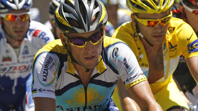 """FILE - In this July 11, 2009 file photo, American seven-time Tour de France winner Lance Armstrong, left, and Rinaldo Nocentini of Italy, wearing the overall leader's yellow jersey, right, climb towards Col de Port, France, during the 8th stage of the Tour de France cycling race with start in Andorra and finish in Saint-Girons, France. When Alex Gibney set out to document the cyclist Armstrong's 2009 Tour de France comeback, the filmmaker admits he bought into the hype: The man who'd cheated death was coming back to reign supreme -- clean. Gibney's documentary, """"The Armstrong Lie, """" from Sony Pictures Classics releases Friday, Nov. 8, 2013. (AP Photo/Christophe Ena, File)"""