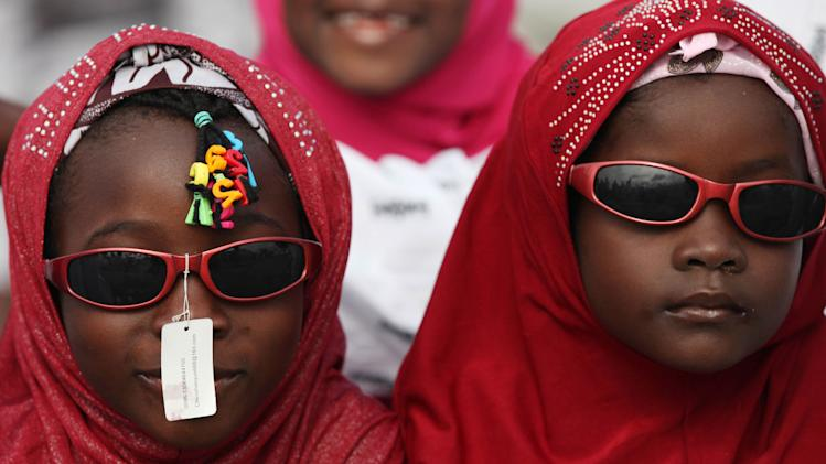 Nigeria  Muslims attends Eid al-Fitr prayers at the Obalende prayer ground in Lagos, Nigeria, Sunday, Aug. 19, 2012. Muslims throughout the world celebrate the Eid al-Fitr holiday after the holy fasting month of Ramadan. (AP Photo/Sunday Alamba)