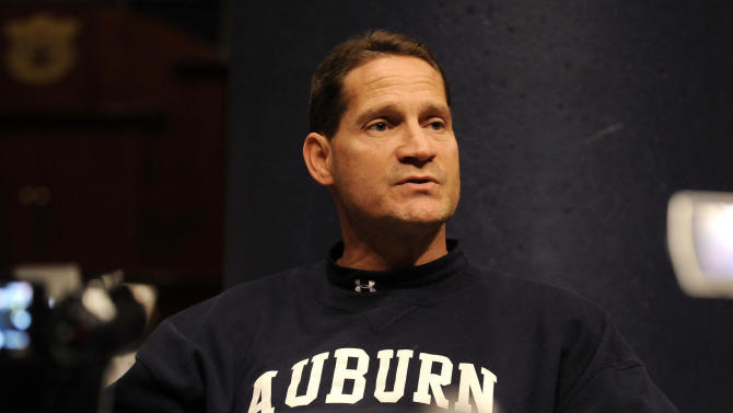 Auburn coach Gene Chizik speaks to reporters following practice about his team's upcoming NCAA college football game against Georgia on Wednesday, Nov. 10, 2010, in Auburn, Ala. All coach Chizik would say Wednesday about Cam Newton is that the star quarterback will start for the second-ranked Tigers against Georgia on Saturday after the latest round of accusations. (AP Photo/Todd J. Van Emst)
