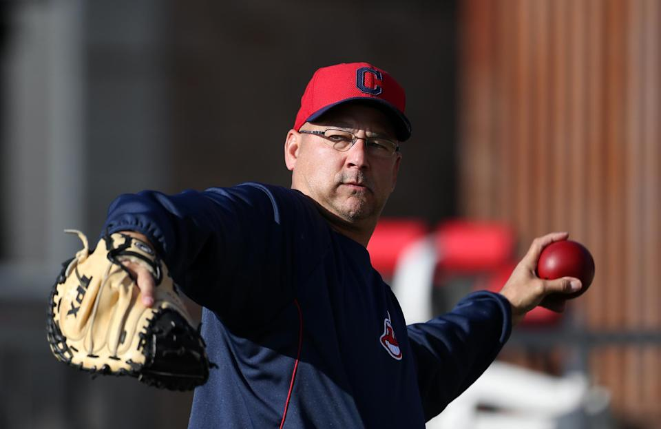 Cleveland Indians manager Terry Francona throws during spring training baseball in Goodyear, Ariz., Tuesday, Feb. 12, 2013.  (AP Photo/Paul Sancya)