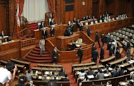 "This file photo shows a general view of a plenary session of the upper house of the parliament in Tokyo, pictured in August. Japanese lawmakers on Friday passed a crucial deficit-financing bond bill that will allow Tokyo to pay for a huge chunk of this year's public spending, avoiding the country's own ""fiscal cliff."""