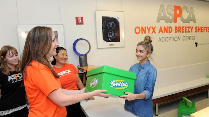IMAGE DISTRIBUTED FOR SWIFFER - Modern Family's Sarah Hyland brings the Swiffer Effect to the ASPCA Adoption Center via the Big Green Box, Monday, Oct. 20, 2014, in New York. Swiffer announced a year-long effort to help support the ASPCA in finding homes for animals in need and help make the challenges of cleaning up after a pet less of a concern. (Photo by Diane Bondareff/Invision for Swiffer/AP Images)