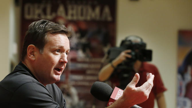 Oklahoma head coach Bob Stoops gestures as he answers a question during an NCAA college football news conference in Norman, Okla., Thursday, March 7, 2013. After a rare overhaul in his coaching staff this offseason, spring football practice begins this weekend. (AP Photo/Sue Ogrocki)