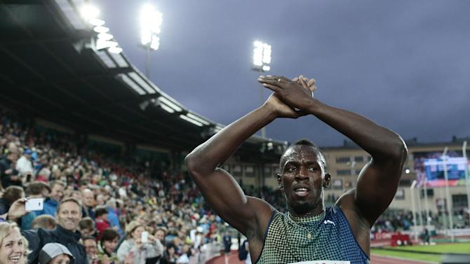 Usain Bolt of Jamaica celebrates after winning the men's 200 metres during the Diamond League athletics competition at the Bislett Stadium in Oslo, Thursday June 13, 2013. (AP Photo/NTB Scanpix, Stian Lysberg Solum) NORWAY OUT