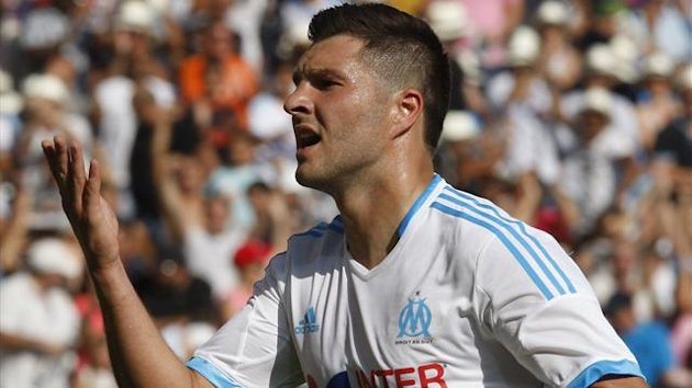 Olympique Marseille's Andre-Pierre Gignac celebrates after scoring a goal against Evian Thonon Gaillard during their French Ligue 1 soccer match at the Velodrome Stadium in Marseille, August 17, 2013. (Reuters)