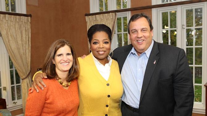 """In this Oct. 27, 2011 photo released by Harpo Inc., Oprah Winfrey, center, poses with New Jersey Gov. Chris Christie, right, and his wife Mary Pat during an interview at the Christie home in Mendham, N.J., for """"Oprah's Next Chapter"""", airing Sunday, Jan. 15, 2012 on OWN.  (AP Photo/Harpo, Inc. George Burns)"""