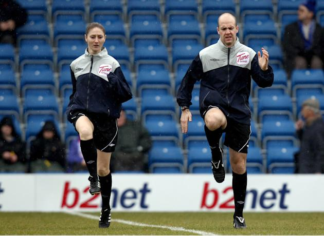 Assistant referee Sian Massey, left, and referee Anthony Taylor warm up before the League Two soccer match between Chesterfield and Aldershot Town, Chesterfield, England, Saturday Feb. 5, 2011. (AP Ph