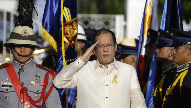 Philippines President Benigno Aquino salutes during arrival honors at the historic Emilio Aguinaldo Shrine in Kawit, Cavite province, south of Manila, Philippines during the 113th Philippine Independence Day celebrations Sunday, June 12, 2011. The shrine was where Philippine independence from Spain was proclaimed on June 12, 1898.(AP Photo/Aaron Favila)