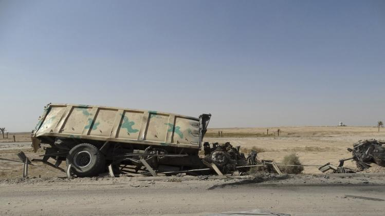 A burnt vehicle belonging to the Iraqi security forces is seen on the outskirt of Haditha