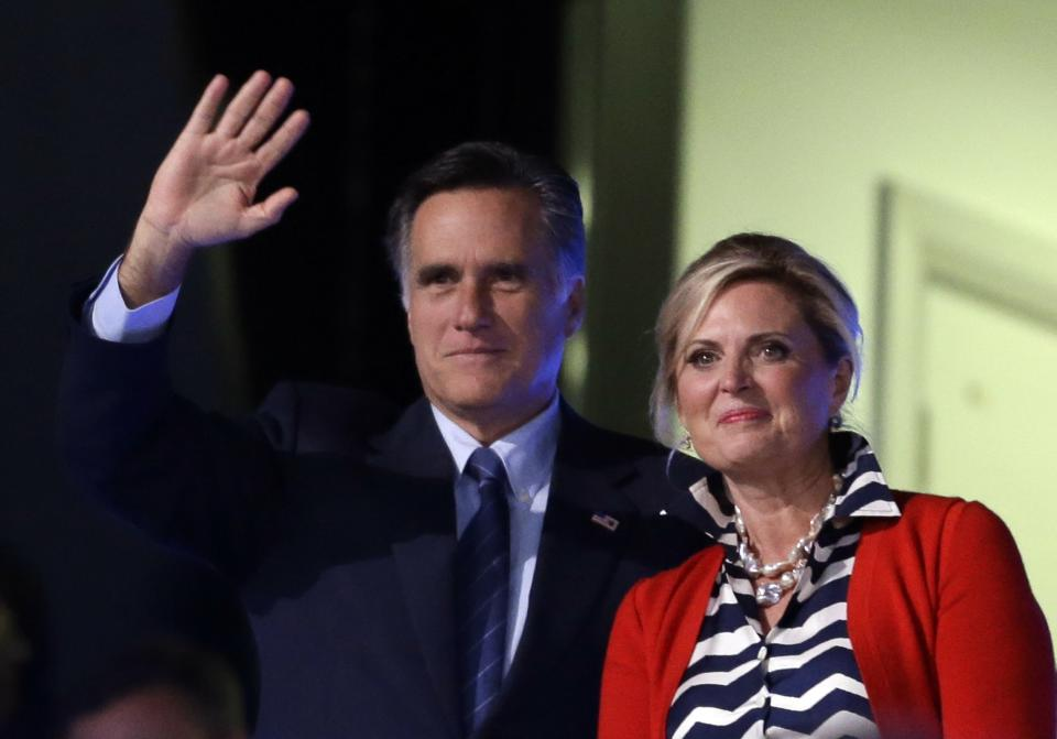 Mitt Romney and his wife Ann attend the Opening Ceremony at the 2012 Summer Olympics, Friday, July 27, 2012, in London. (AP Photo/David Goldman)