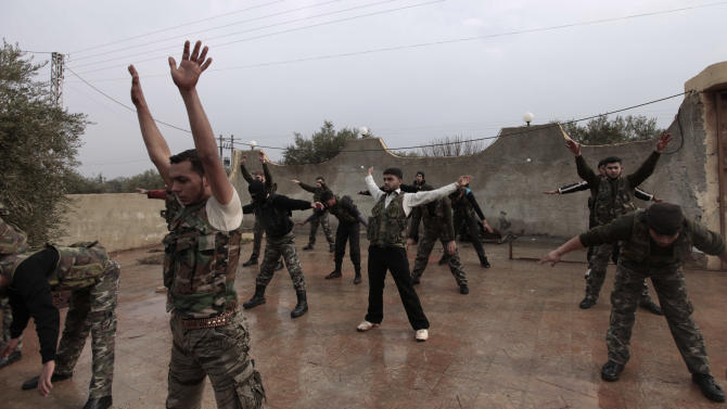 In this Monday, Dec. 17, 2012 photo, Syrian rebels attend a training session in Maaret Ikhwan, near Idlib, Syria, Monday, Dec. 17, 2012. The training is part of an attempt to transform the rag-tag rebel groups into a disciplined fighting force. (AP Photo/Muhammed Muheisen)