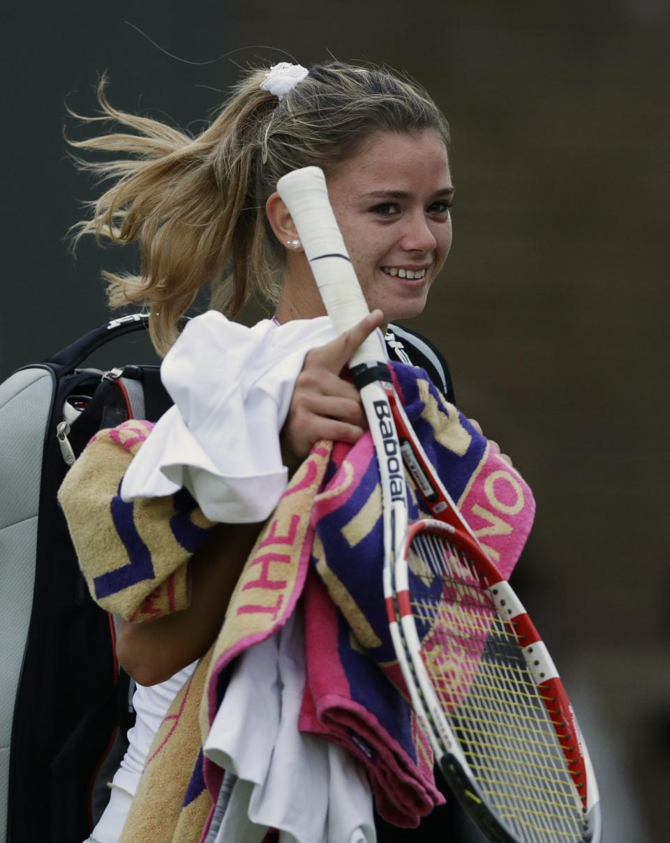 Camila Giorgi of Italy reacts after defeating Nadia Petrova of Russia during a third round women's singles match at the All England Lawn Tennis Championships at Wimbledon, England, Friday, June 29, 2012. (AP Photo/Kirsty Wigglesworth)