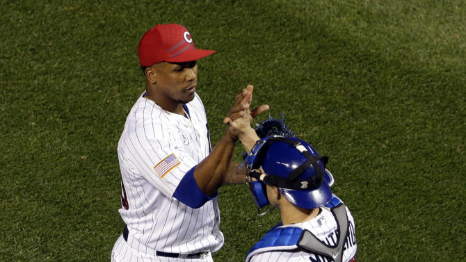 Chicago Cubs relief pitcher Pedro Strop, left, celebrates with catcher Miguel Montero after the Cubs defeated the Miami Marlins 7-2 in a baseball game Saturday, July 4, 2015, in Chicago. (AP Photo/Nam Y. Huh)