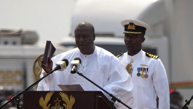 President John Dramani Mahama, foreground  speaks during his inauguration ceremony, in Accra, Ghana, Monday, Jan. 7, 2013. Ghana's President John Dramani Mahama was sworn in Monday for a new four-year term in the West African nation's capital of Accra after winning a closely fought election in December. (AP Photo/Gabriela Barnuevo)