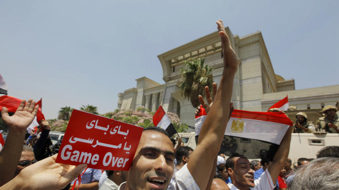"""Egyptians celebrate after Egypt's chief justice Adly Mansour is sworn in as the nation's interim president Thursday, July 4, 2013. Arabic reads, """" bye bye Morsi."""" The chief justice of Egypt's Supreme Constitutional Court was sworn in Thursday as the nation's interim president, taking over hours after the military ousted the Islamist President Mohammed Morsi. (AP Photo/Amr Nabil)"""