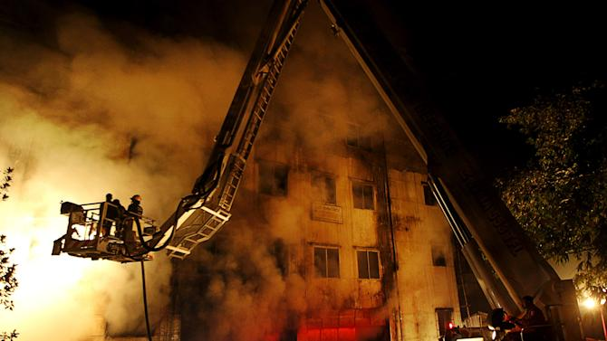 Bangladesh probe: Fire sabotage, owner negligent