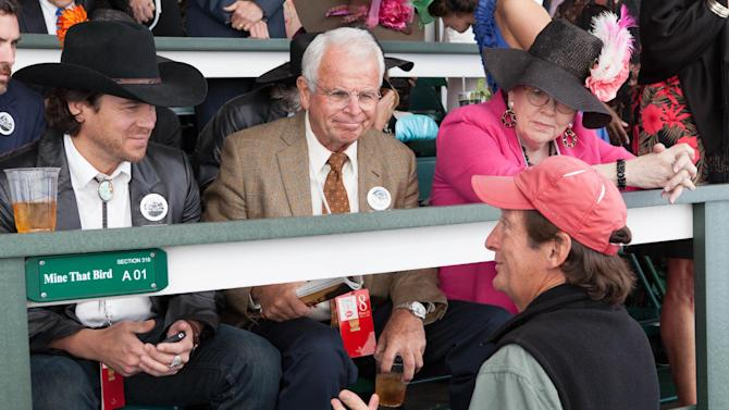 """In this Oct. 18, 2012 image provided by Allied-THA, from left to right, Mark Allen, played by actor Christian Kane, Leonard 'Doc' Blach played by William Devane, producer and director Jim Wilson and Joanne Blach, played by Tish Rayburn-Miller, talk about a scene during filming at Churchill Downs for the movie """"50-1."""" (AP Photo/Ben Glass, Courtesy of Allied-THA)"""