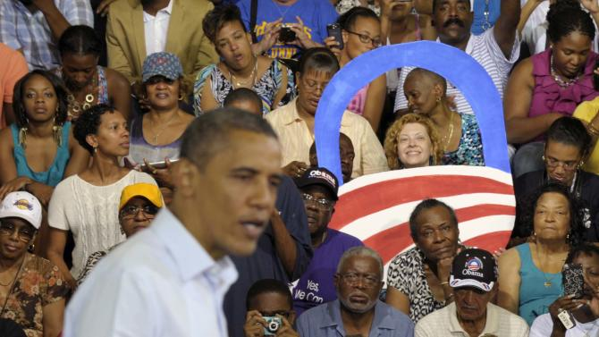 President Barack Obama speaks at a campaign event at Phoebus High School in Hampton, Va., Friday, July 13, 2012. Obama is spending the day in Virginia campaigning. (AP Photo/Susan Walsh)
