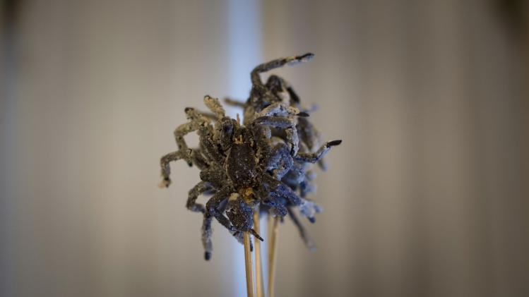 Cooked tarantulas on skewers are seen at the 110th Explorers Club Annual Dinner at the Waldorf Astoria in New York