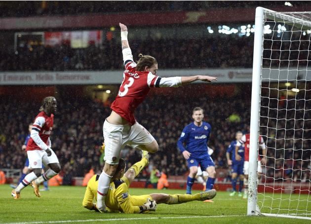 Cardiff City goalkeeper Marshall lands on Arsenal's Bendtner's foot as he scores his goal during their English Premier League soccer match in London