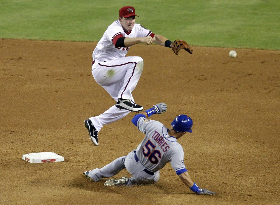 New York Mets' Andres Torres (56) is forced out as Arizona Diamondbacks' Stephen Drew turns a double play on the Mets' Rob Johnson during the sixth inning of a baseball game on Thursday, July 26, 2012, in Phoenix.  (AP Photo/Matt York)