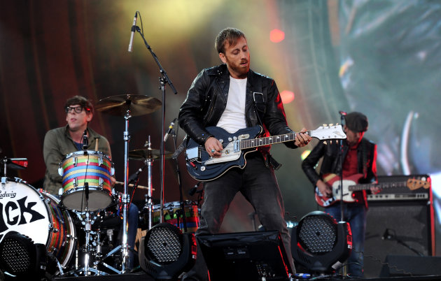 FILE - In this Sept. 29, 2012 file photo, guitarist Dan Auerbach, center, and drummer Patrick Carney of The Black Keys perform at the Global Citizen Festival in Central Park, in New York. (AP Photo by Evan Agostini/Invision/AP, File)