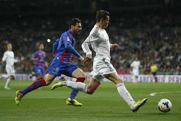 Real's Gareth Bale, right, in action with Levante's Nikolaos Karampelas 'Nikos' during a Spanish La Liga soccer match between Real Madrid and Levante at the Santiago Bernabeu stadium i