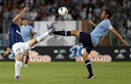 Lazio's Mauri challenges Inter Milan's Cambiasso during their Italian Serie A soccer match the Olympic stadium in Rome