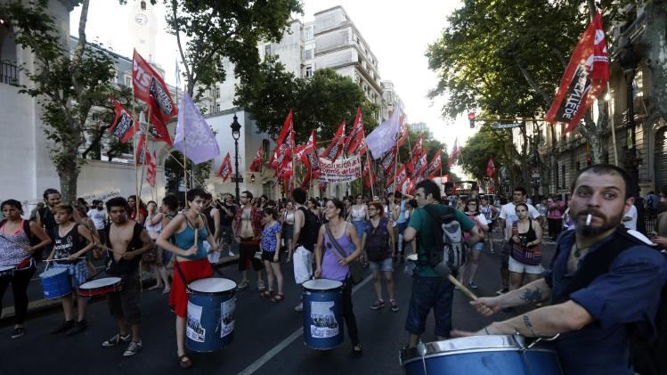 Demonstrators beat drums during a rally to commemorate the 12th anniversary of the social and economic crisis that led to Argentine President Fernando De la Rua's resignation in Buenos Aires