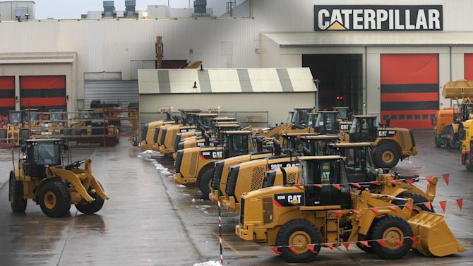 A wheel loader parks at the parking lot of Caterpillar Belgium, in Gosselies, Belgium, Thursday, Feb. 28, 2013. Construction equipment maker Caterpillar says it will cut more than one in three jobs at its Belgium plant, because of high labor costs and sluggish growth in its European market. (AP Photo/Yves Logghe)