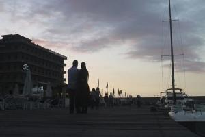 Couple stands on the pier at Saint-George Yacht Club & Marina in Beirut