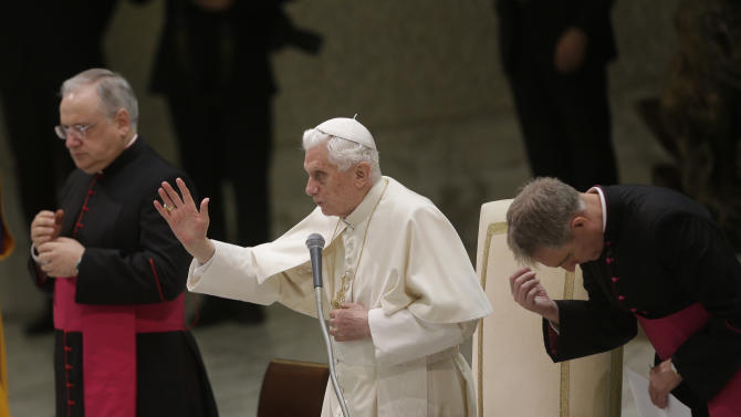 Pope Benedict XVI, center, delivers his blessing during the weekly general audience in the Paul VI hall at the Vatican, Wednesday, Nov. 28, 2012. (AP Photo/Alessandra Tarantino)