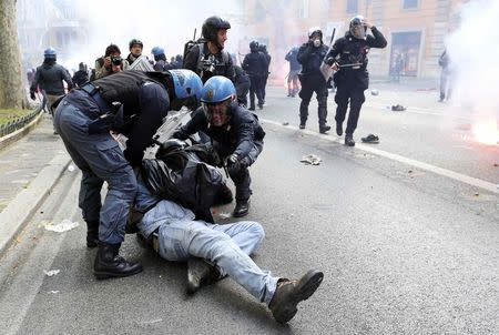 File photo of a demonstrator detained by police during a protest against austerity measures in downtown Rome