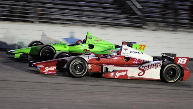 Justin Wilson (18), of England, competes against James Hinchcliffe (27) coming out of Turn 4 during the IZOD IndyCar Firestone 550 auto race at Texas Motor Speedway, Saturday, June 9, 2012, in Fort Worth, Texas. Wilson won the race. (AP Photo/Larry Papke)