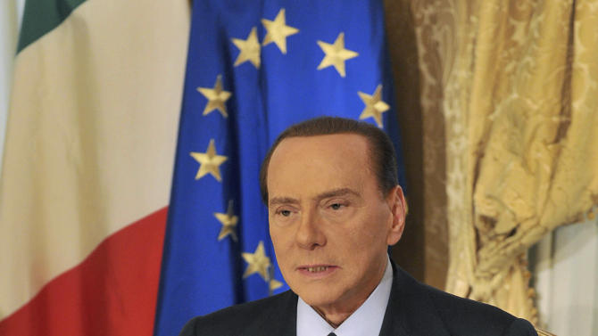 """In this photo released by the Berlusconi press office Thursday, Oct. 25, 2012, former Italian premier Silvio Berlusconi tapes a video message where he announces he will not run for a fourth term as premier in spring elections. Berlusconi has until now been coy about his intentions. But the three-time former premier posted a statement on his movement's website yesterday, under the headline: """"I won't run for premier."""", following today with a video where he confirms his intentions. (AP Photo/Livio Anticoli, Berlusconi press office)"""