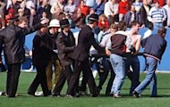 File photo shows policemen rescuing soccer fans at Hillsborough stadium on April 15, 1989, when 96 fans were crushed to death and hundreds injured after support railings collapsed during a match between Liverpool and Nottingham Forest