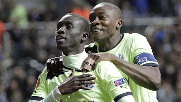 Newcastle United's Senegalese striker Papiss Cisse celebrates scoring against Bordeaux with Shola Ameobi (R) (AFP)