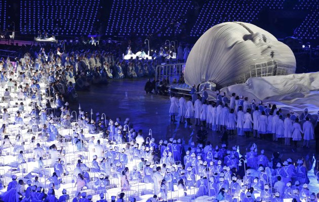 Performers take part in the opening ceremony of the London 2012 Olympics Games at the Olympic Stadium