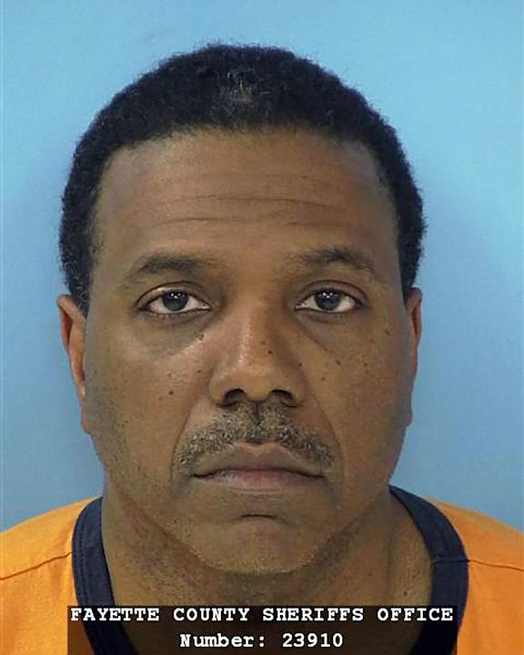 FILE- This June 8, 2012, file photo, provided by the Fayette County Sheriff's Office shows megachurch pastor Creflo Dollar. Dollar denied Sunday, June 10, that he punched and choked his 15-year-old da