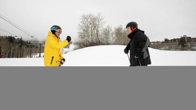 IMAGE DISTRIBUTED FOR THE RITZ-CARLTON REWARDS/E CREDIT CARD FROM J.P. MORGAN - A card member of The Ritz-Carlton Rewards/E Credit Card from J.P. Morgan enjoys an exclusive ski instruction session with Olympic gold-medalist Jonny Moseley, left, at The Ritz-Carlton Bachelor Gulch on Beaver Creek Mountain in Avon, Colo., on Friday, Jan. 25, 2013. Ritz-Carlton card members who attended the private ski experience enjoyed a weekend at The Ritz-Carlton Bachelor Gulch, access to Beaver Creek and a dinner at Spago with Wolfgang Puck. (Photo by Jack Dempsey/Invision for The Ritz-Carlton Rewards/E Credit Card from J.P. Morgan/AP Images)