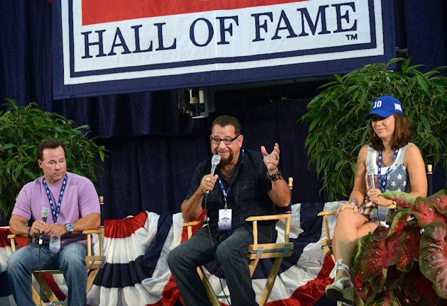 2012 National Baseball Hall of Fame Inductee, Ron Santo's children from left, Ron Santo; Jr., Jeff Santo and Linda Santo speak at an inductee press conference as part of the National Baseball Hall of Fame ceremonies in Cooperstown, N.Y., Saturday, July 21, 2012. (AP photos/Heather Ainsworth)